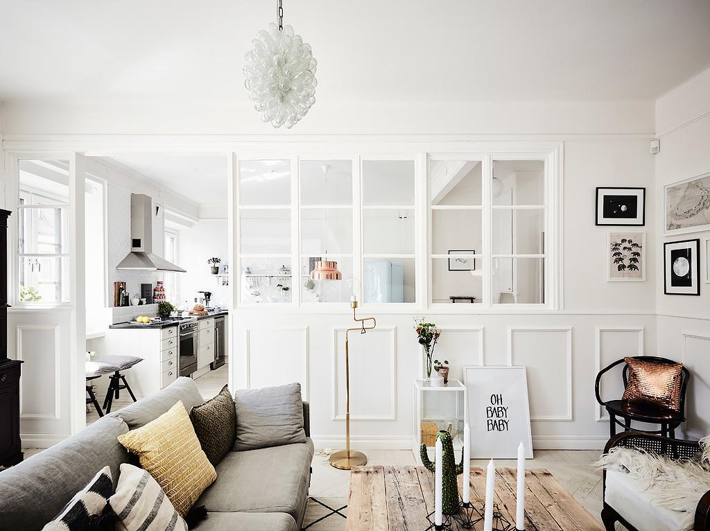 una parete divisoria in vetro e legno in the mood for design