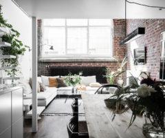 Interior Inspiration: doppia altezza e mattoni a vista per un interno nordico