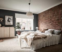 Get the look: mattoni a vista per una stanza da letto calda e accogliente
